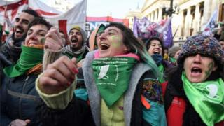 Pro-choice activists wait outside the Argentine Congress in Buenos Aires before the approval of a bill to legalise abortion.