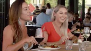Two women have lunch in a still from the Rockhampton tourism video