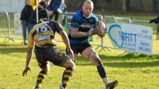 An action shot of Ross Cornwell playing rugby