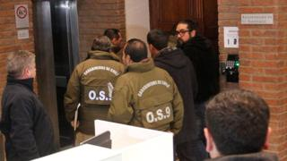 Chilean police officers are seen during the confiscation of the documents inside the office of the Ecclesiastical Court of the archdiocese of Santiago, Chile, June 13, 2018.