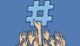 hands holding a hashtag