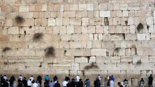 Israelis and tourists pray at the Western Wall in Jerusalem's Old City, 21 November 2010