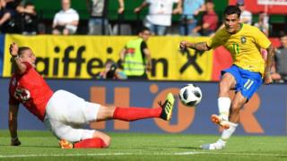 Brazil's midfielder Philippe Coutinho Correia scores the third goal for Brazil during the international friendly footbal match Austria on 10 June