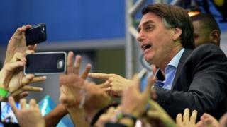 Jair Bolsonaro is greeted by supporters in Rio de Janeiro, Brazil. Photo: 22 July 2018