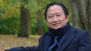 This undated picture received on August 2, 2017 shows Vietnamese national Trinh Xuan Thanh sitting on a park bench in Berlin.