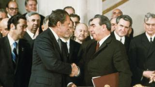 President Nixon and Soviet Premier Brezhnev shake hands after signing the first Salt treaty.