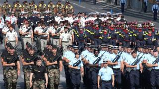 Gendarmes, firefighters and other units march
