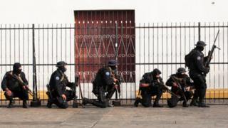 Members of Nicaragua's Special Forces are seen next to a church during clashes with anti-government protesters in the indigenous community of Monimbo in Masaya, 14 July 2018