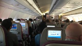Passengers on board Malaysia Airlines flight MH122