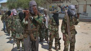 Al-Qaeda linked al-shabab recruits walk down a street on March 5, 2012 in the Deniile district of Somalian capital, Mogadishu, following their graduation