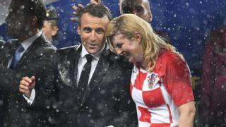 French President Emmanuel Macron (left) talks with Croatian President Kolinda Grabar-Kitarovic during the trophy ceremony at the end of the Russia 2018 World Cup final football match between France and Croatia