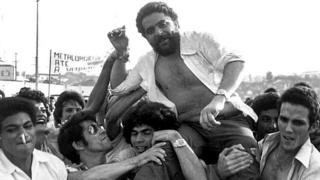 This 22 March 1979 file photo shows Luiz Inacio Lula da Silva being lifted by metalworker colleagues after a union rally in Sao Bernardo do Campo, 55kms from Sao Paulo. Da Silva, presidential candidate for the Workers' Party, has been declared the winner of the presidential election run-off 27 October, 2002.