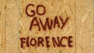 A message is posted on a boarded up building before the arrival of Hurricane Florence on Oak Island, North Carolina