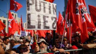 Russian Communist party supporters and country's left-wing movements carry red flags as they take part in a rally against the government's proposed reform hiking the pension age - 2 September