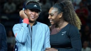 Serena Williams laughs with a tearful Naomi Osaka after the Japanese player's US Open victory