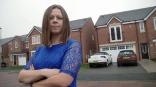 Katie Kendrick outside her home