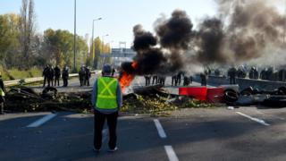 Riot police face protestors blocking the ring-road in Bordeaux, France
