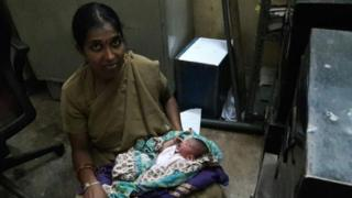 Police woman Archana with the newborn