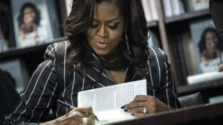 Former US First Lady Michelle Obama signs copies of her new book