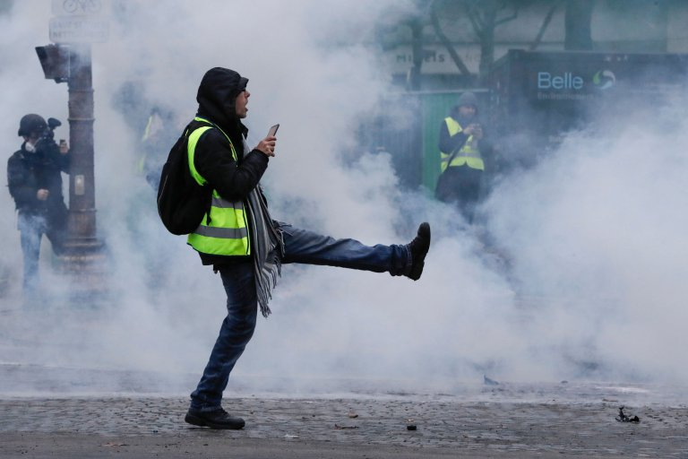 A protestor dressed in yellow vest (