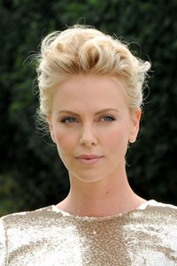 Queen of the crops Charlize Theron channels Hollywood glamour with a styled back fringe that really opens up her face.