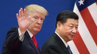 This file picture taken on November 9, 2017, shows US President Donald Trump (L) and China