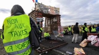 Gilets jaunes protesters block the road leading to the Frontignan oil depot in the south of France on 3 December 2018