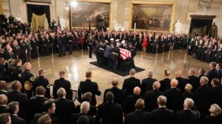 President George HW Bush lies in state at the US Capitol