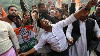 Supporters of India's main opposition Congress party celebrate after the initial poll results at the party headquarters in New Delhi, India, December 11, 2018