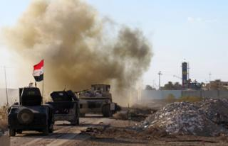 Iraqi forces drive their armoured vehicles in the Jwaibah area, on the eastern outskirts of Ramadi, on February 8, 2016, after they retook the region from Islamic State