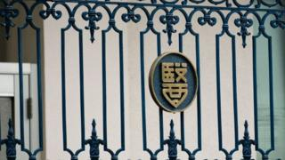 The emblem of the Tokyo Medical University is seen on the building's entrance gate in Tokyo on August 8, 2018.