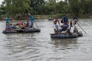 After waiting for more than 36 hours at the border bridge, some of the migrants crossed the border on rafts