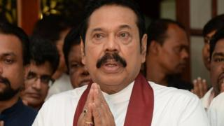 Mahinda Rajapaksa attends a religious ceremony after he resigned from the prime minister post in Colombo, Sri Lanka December 15, 2018