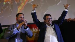 Spain's far-right VOX party leader Santiago Abascal and regional candidate Francisco Serrano celebrate results after the Andalusian regional elections in Seville
