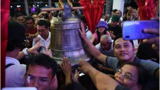 Crowds celebrate the return of the Balangiga bells to the Philippines
