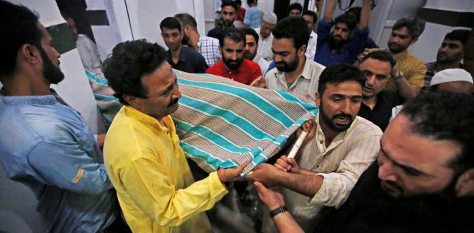 Journalist, police bodyguards killed by means of assailants in Kashmir – The Globe and Mail