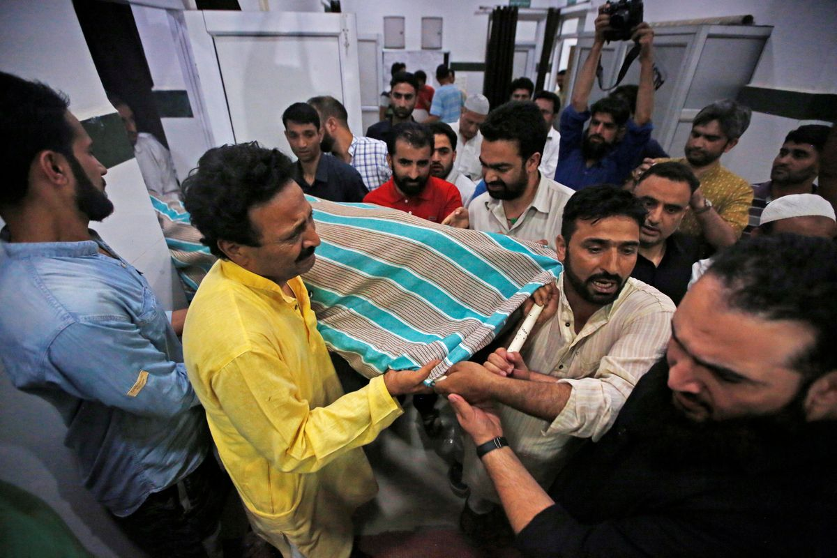 Journalist, police bodyguards killed by means of assailants in Kashmir - The Globe and Mail