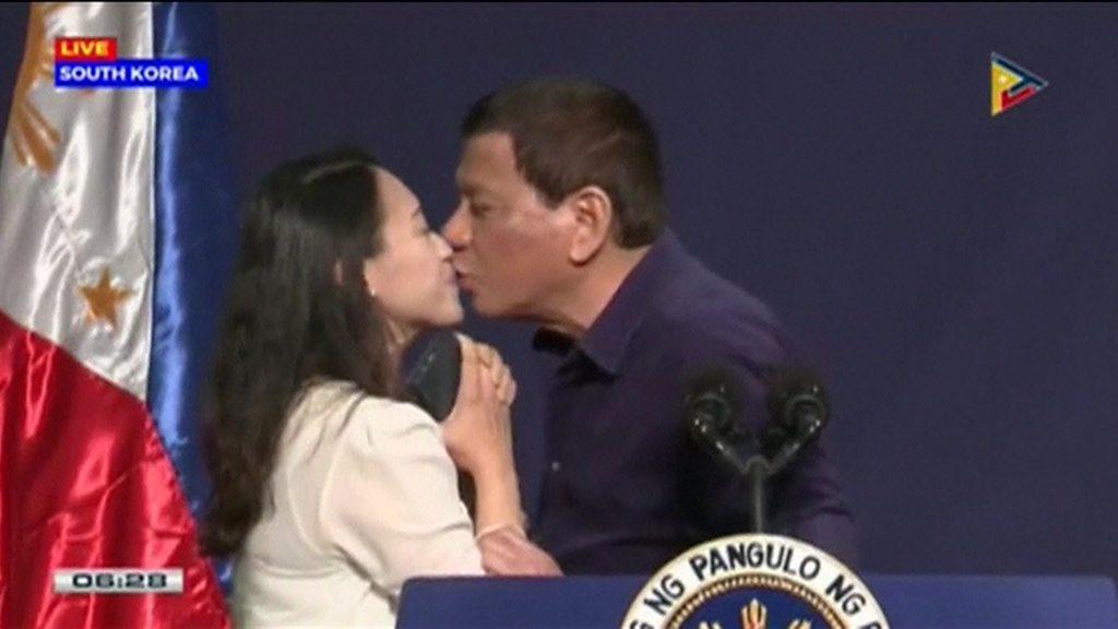 Philippine President Duterte condemned for kissing overseas employee
