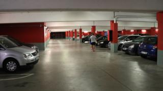 A picture taken on July 25, 2018 in the northern Paris suburb of Sarcelles shows the parking where the car abandoned by French robber Redoine Faid was found.
