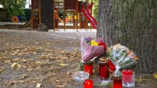 Candles and flowers displayed at a playground after the killing of a 22-year-old German man in a fight in Koethen.