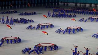 Athletes doing a gymnastics performance