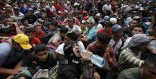 Honduras migrant caravan crosses Guatemala border, heads for U.S.