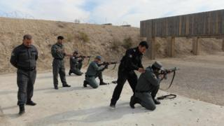 In this photo taken on November 21, 2018, newly-recruited Afghan policemen display their skills at a police training centre in Mazar-i-Sharif.