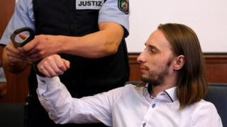 Sergei Wenergold arrives for his verdict at a court in Dortmund, Germany, November 27, 2018
