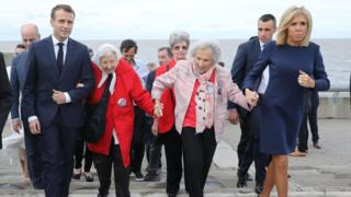 French President Emmanuel Macron and wife Brigitte Macron walk with Vera Vigevani de Jarach and Lita Boitano during a visit to the Remembrance Park in Buenos Aires. 29 Nov 2018