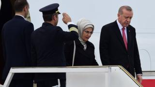 Turkish President Recep Tayyip Erdogan and his wife Emine Erdogan step off their plane upon arrival in Buenos Aires on November 29, 2018
