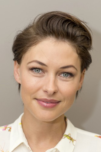 To give your crop a modern update, style the front section away from your face for a soft look like Emma Willis.