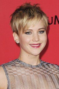 Just in time for the release of The Hunger Games, Hollywood star Jennifer Lawrence chopped off her long locks into a textured pixie crop.