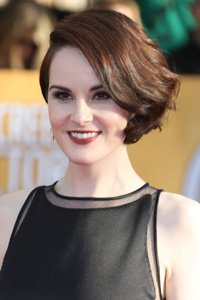 A great way to glam up short hair, copy Michelle Dockery and part your hair in a deep side parting before waving the end sections to add some volume to your style.