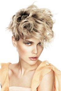 Shaggy blonde layered crop by Rae Palmer